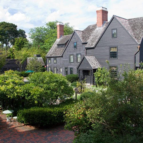 Exterior view of the House of the Seven Gables and garden on a beautiful sunny day.