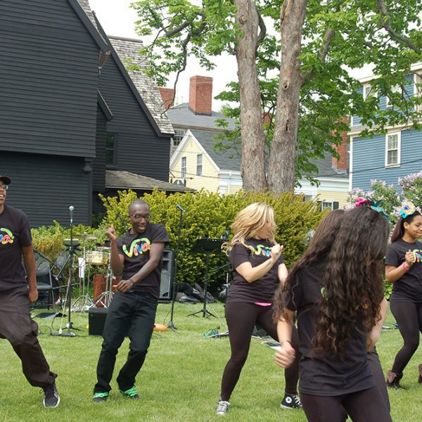Express yourself group dancing outside of the House of the Seven Gables.
