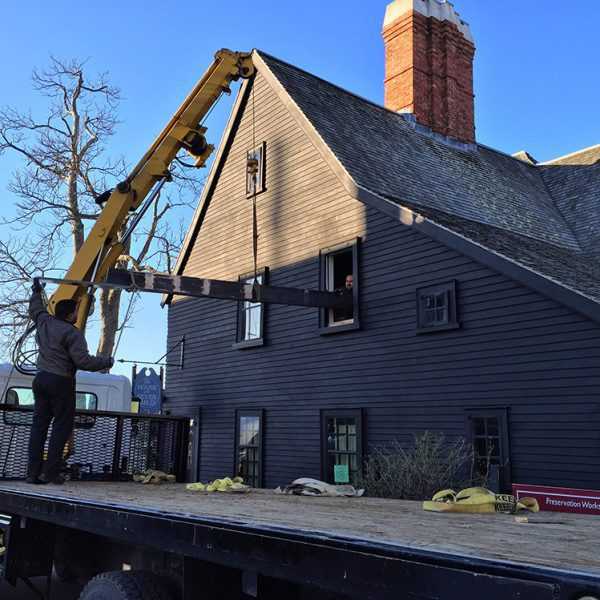 The House of the Seven gables under construction. A truck is parked right outside.