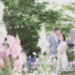 A couple who got married at The House of the Seven Gables surrounded by flowers