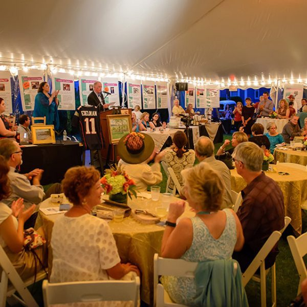 An event held under a tent with many people attending.