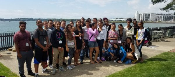 Group seaside photo of group of high school aged kids | Settlement Programming