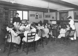 Old Photo of Children Sitting at Table | House of 7 Gables Mission | Settlement Program