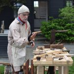 Mike Welch offers a demonstration of historical carpentry at The House of the Seven Gables