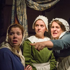 Three young women perform in Legacy of the Hanging Judge