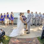 A bridal party getting married on the compass rose at The House of the Seven Gables