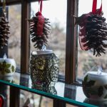 Pinecones and candleholders for sale in the gables museum store