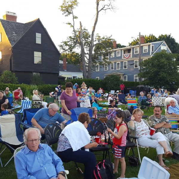 The seaside lawn at The House of the Seven Gables is full of people ready to celebrate the Fourth of July