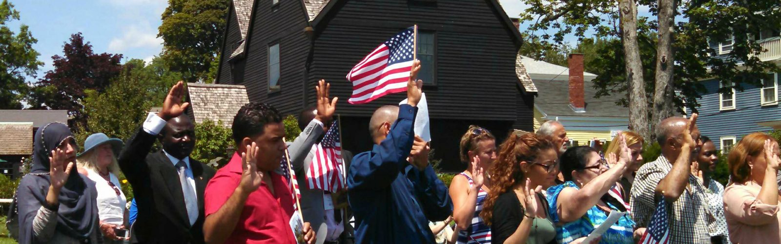 Picture of new American citizens being sworn in at The House of the Seven Gables