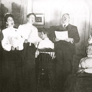The Upton family in the parlor of the Gables singing