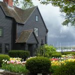 Exterior Image of The House of the Seven Gables with tulips in bloom
