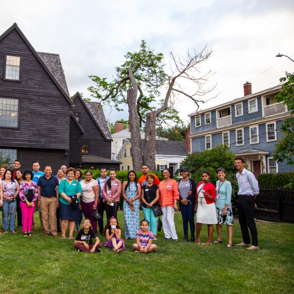 A group gathering at The House of the Seven Gables after a tour