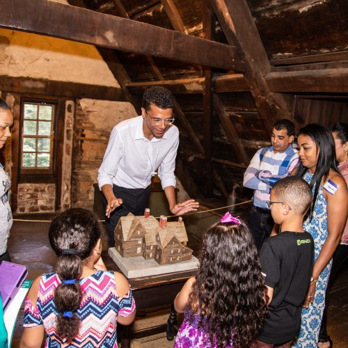 A guide shares information with visitors in the attic of The House of the Seven Gables