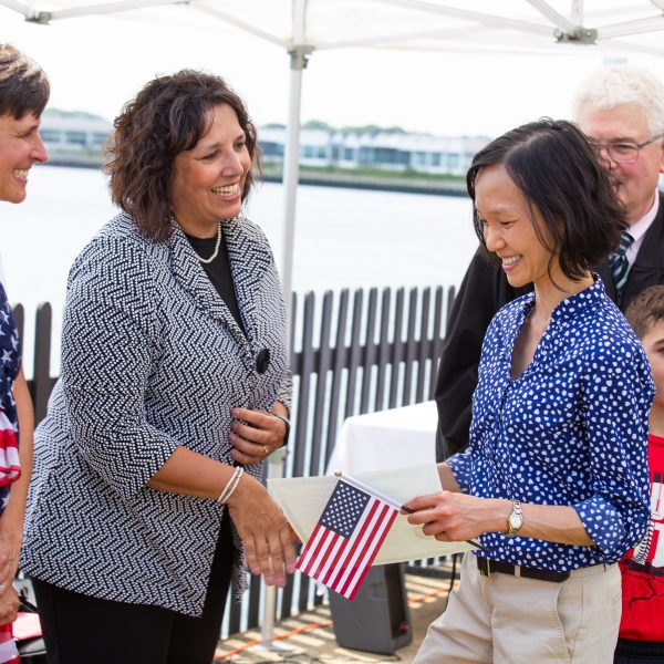 Mayor Kim Driscoll of Salem welcomes a new citizen at a Naturalization Ceremony at The House of the Seven Gables