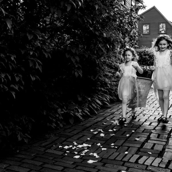 Two flower girls at a wedding at The House of the Seven Gables