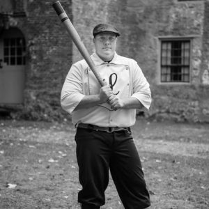 A man in a vintage baseball uniform
