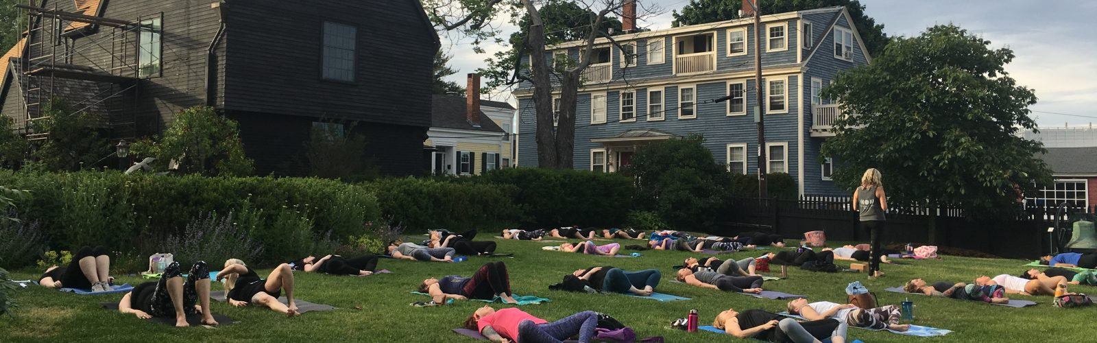 Yoga practice on the Seaside Lawn at The House of the Seven Gables