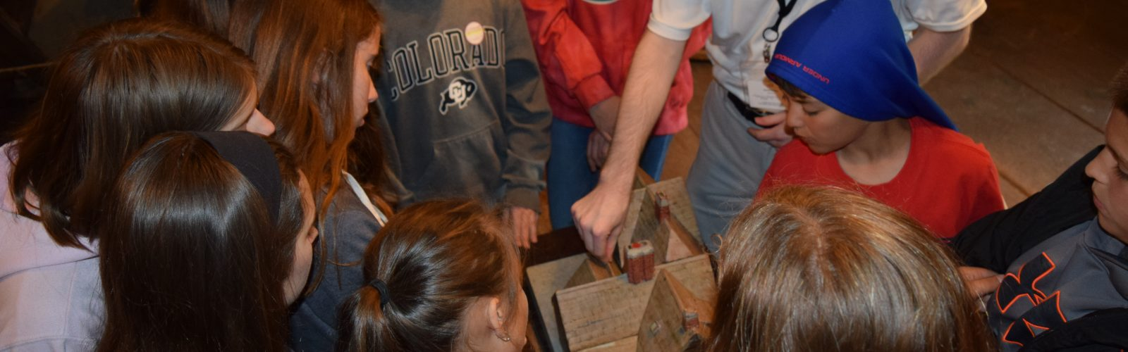 A guide with school-age children at The House of the Seven Gables