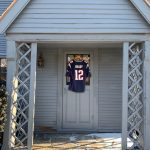 Tom Brady jersey hanging on the side door of The House of the Seven Gables