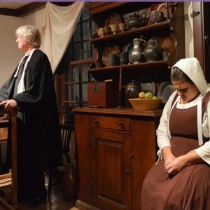 Anne Putnam bows her head in the Legacy of the Hanging Judge October Performance