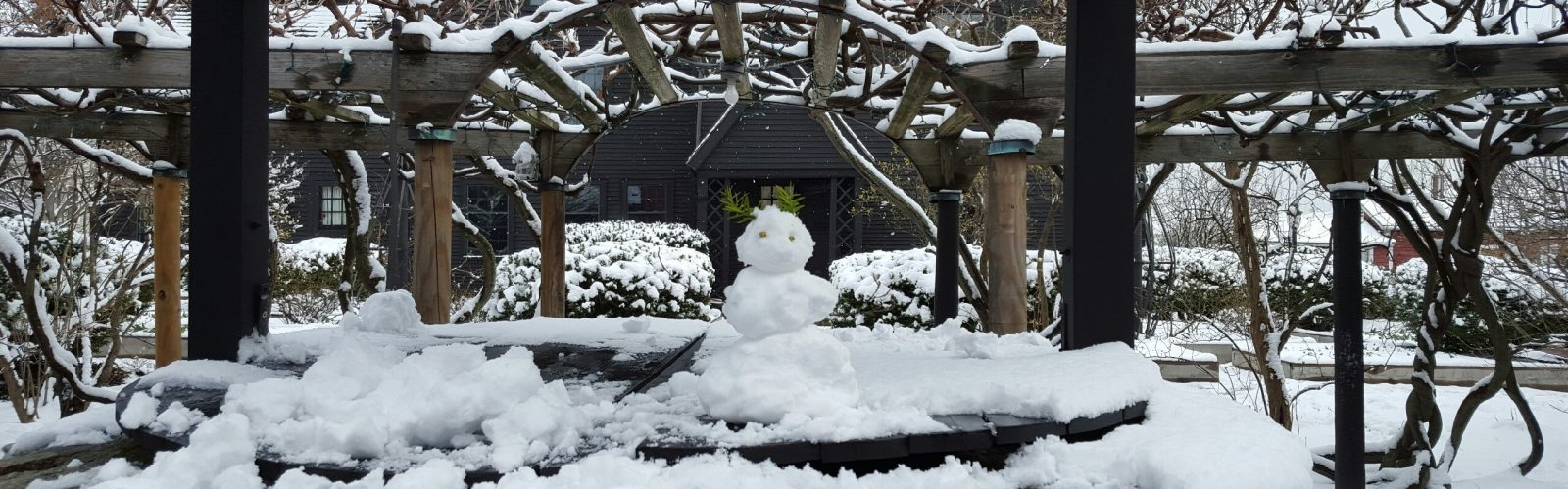 A snowman on the well at The House of the Seven Gables