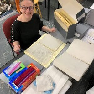 A woman working in a museum archive