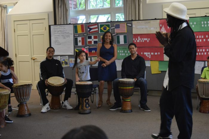 Camp students in a drum circle at The House of the Seven Gables