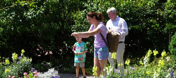 A family explores the gardens at The House of the Seven Gables
