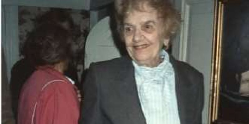 photograph of an older woman in a suit