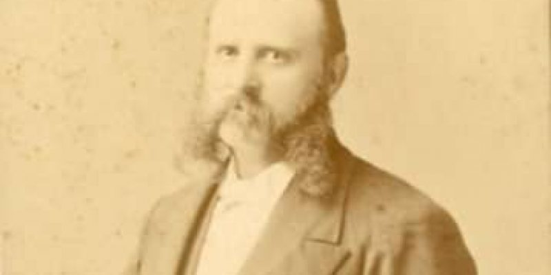 A photograph of a man with impressive mutton chops.