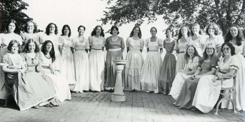 Black and white photo of women in handmade dresses