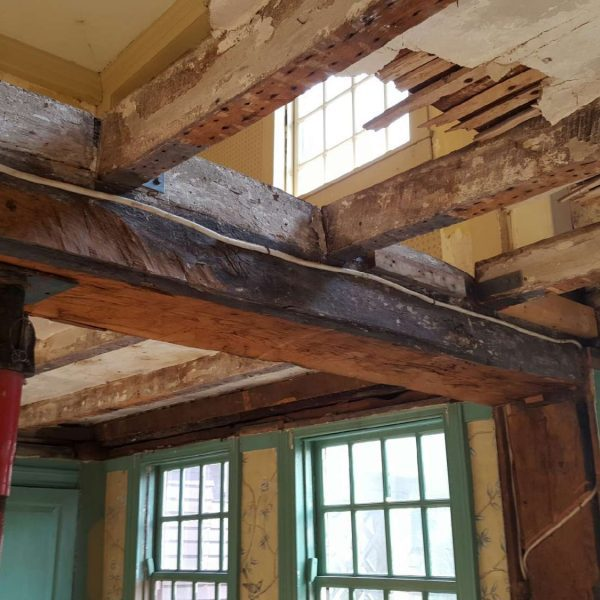 photograph of structural members that were on view during the structural restoration of the summer beam at The House of the Seven Gables in 2016