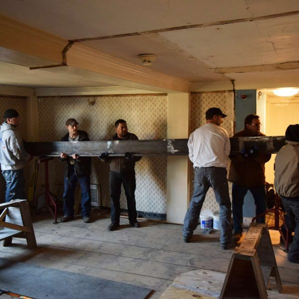 photograph of the crew from American Steeple and Tower and Cassidy Bros. installing the steel beam at The House of the Seven Gables during the 2016 restoration project.