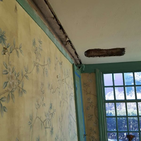 Photo of the removal of the Georgian crown moulding in the dining room at The House of the Seven Gables during the 2016 restoration project.