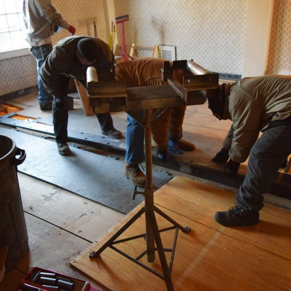 photograph of Crew from American Steeple and Tower and Cassidy Bros. installing the steel beam at The House of the Seven Gables during the 2016 restoration project.