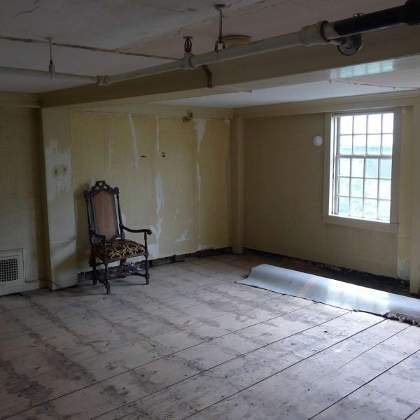 Photo of the Dining Room Chamber in The House of the Seven Gables during the structural restoration project.