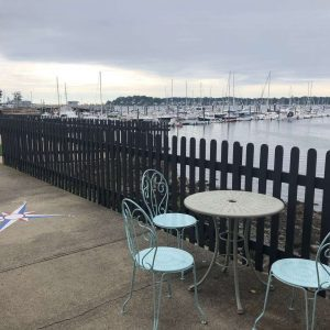Table and chairs overlooking the harbor at The Gables