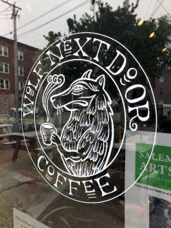 Photo of Wolf Next Door Coffee Shop Window with Logo