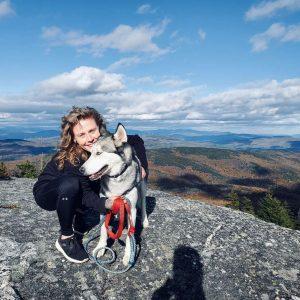 Photo of Settlement House ESL teacher Margo Fijux and her dog Cobalt
