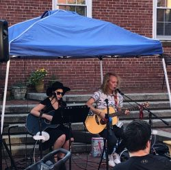Photo of musicans preforming live music at the Salem Farmers' Market August 2021