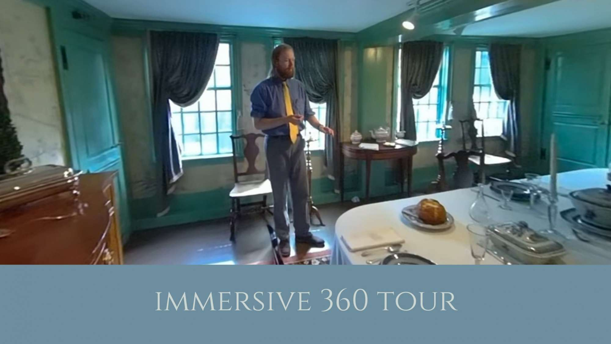 man in a dining room in a historic house